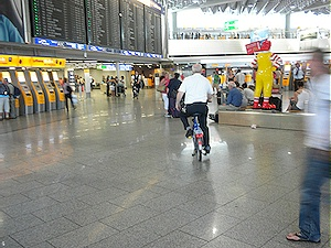 Frankfurt airport employee cycling on a work bike July 2010. Photo by HJEH Becker