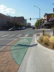 Missoula MT, Bike Path at sidewalk level entering intersection, Coloured transition through intersection ©Photograph by H-JEH Becker, 2012
