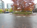 Portland OR, Traffic circle with sharrows highlighting where motorists may encounter cyclists ©Photograph by H-JEH Becker, 2012